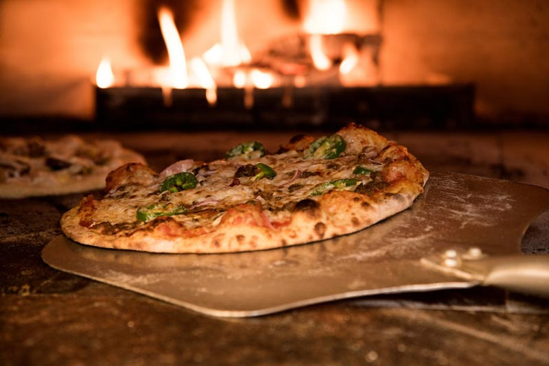 pizza in fire oven